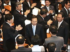 President Lee Myung-bak is applauded by deputies after delivering a speech to the National Assembly in Seoul on Friday