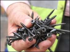 Green Works' founder holding screws