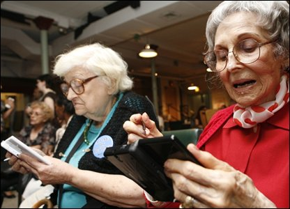 Pensioners playing with a Nintendo DS, AP