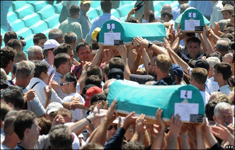 People pass the coffin of a victim of Srebrenica over the crowd