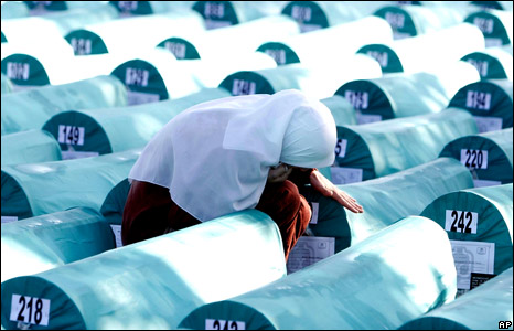 A woman grieves over the coffin of a relative at Srebrenica