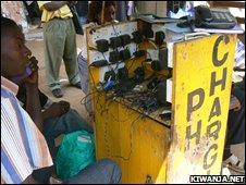 Man at phone charging station
