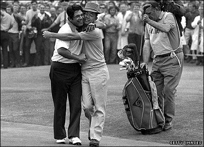 "Lee Trevino is hugged by ""Mr Lu"" after winning the first of his two Open titles"