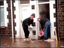 Residents bail out a flooded home in Treforest, Pontypridd