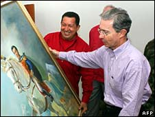 Hugo Chavez presents Alvaro Uribe with a portrait of Simon Bolivar