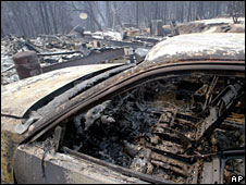 The remnants of a burned home and car in Concow, California
