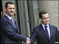 French President Nicolas Sarkozy welcomes Syrian President Bashar Assad