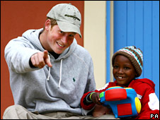 Prince Harry playing with four year old Molise during a visit to the Lesotho Child Counselling Unit in Maseru, Lesotho, Africa.