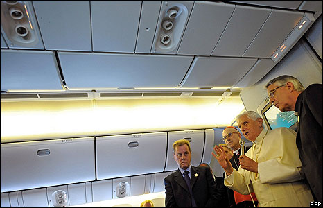 Pope addresses media on board flight