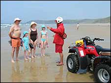 Lifeguard on Perranporth beach, Cornwall