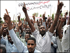 Hundreds of Sudanese shout slogans during a protest in Khartoum, 13 July 2008