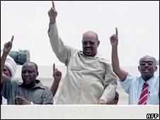 Sudanese President Omar Bashir (C) gestures to the crowd from the roof of the parliament building, Khartoum, 13 July 2008