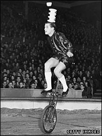 A circus unicyclist