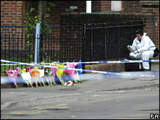 Forensic officer and flowers at the murder scene in Gatehouse Avenue area of Withywood, Bristol.