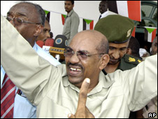 President Omar al-Bashir gestures to pro-government demonstrators