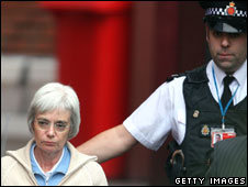 Anne Darwin and a police officer