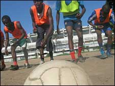 Schoolboy footballers practising outside the National Stadium in Lagos