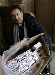 German official displays confiscated cigarettes