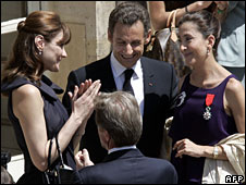 Ingrid Betancourt (R) is congratulated by French First Lady Carla Bruni Sarkozy as French President Nicolas Sarkozy looks on at the Elysee Palace in Paris, 14 July 2008