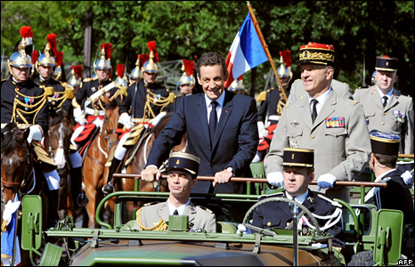 Nicolas Sarkozy (left) and Chief of the Defence Staff Gen Jean-Louis Georgelin on board an army jeep