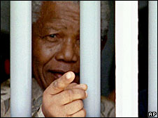 Nelson Mandela looking out of his old cell at Robben Island