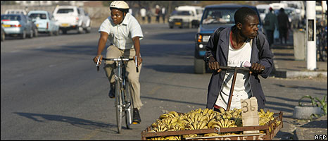 A Zimbabwean street vendor is on his way to a market in Harare on July 10, 2008 as talks start in South Africa between the government and opposition