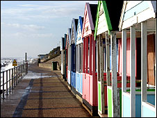 Colourful beach huts along the promenade at Southwold, Suffolk
