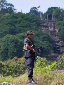 A Thai soldier stands in front of Preah Vihear temple in the background