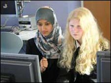 Yusrah, 13, and Joanna, 12, record their news report