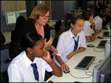 BBC journalist Lynne Jones gives editorial guidance to Katrina and Iris, both 12