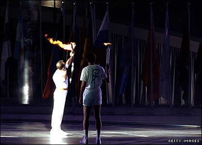 An archer fires a flaming arrow to 'light' the Olympic flame at the Barcelona 1992 Olympics