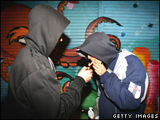Young boys share a cigarette on UK council estate