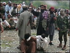 Taleban militants carry out a public killing in Bajaur