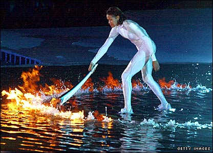 Australian athlete Cathy Freeman lights the Olympic flame at the opening ceremony of the Sydney 2000 Games