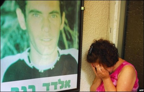 Mourner at home of Eldad Regev