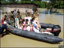 Inflatable boat carries people displaced by flooding