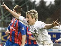 Chris Maguire celebrates a goal