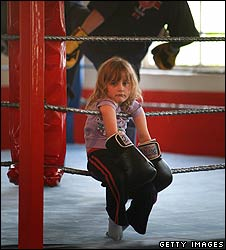 Child wearing boxing gloves