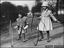 Children with hoop and stick