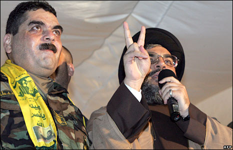 Hezbollah leader Hassan Nasrallah (R) gestures as he welcomes the released prisoners, including Samir Qantar, back to Lebanon