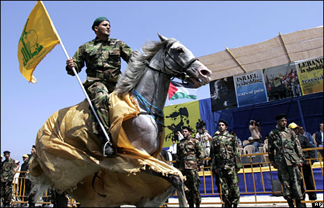 A Hezbollah militant rides on horse back in Naqoura, southern Lebanon, 16 July, 2008