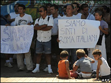 A Roma family take part in a demonstration against the fingerprinting in Rome, 10 July