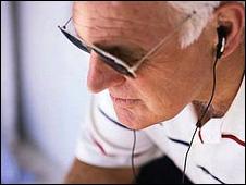 Older person wearing music earphones