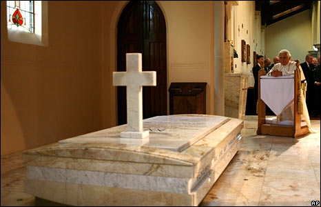Pope Benedict prays at Mary MacKillop's tomb during his visit to Mary MacKillop Chapel