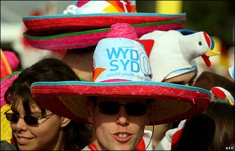 A man wears a hat with the World Youth Day slogan on as he waits to see the Pope