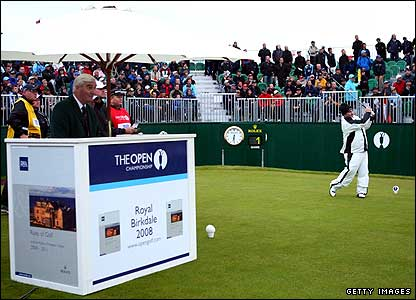 Ivor Robson stands in his starter's hut as Craig Parry hits the first ball of the Open