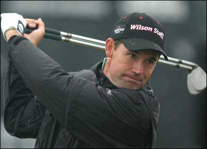 Padraig Harrington warms up on the driving range before his first round