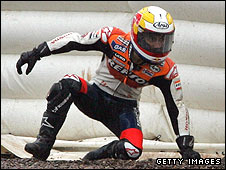 Dani Pedrosa picks himself up after his crash in Germany
