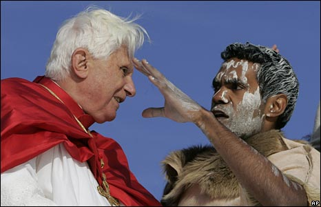 Pope Benedict talks to an Aboriginal man on the boat across Sydney Harbour