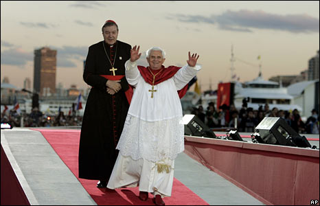 The Pope, followed by Cardinal George Pell, arrives in the suburb of Barangaroo to deliver an address